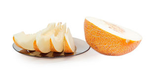 Several slices and half of melon on a light background Stock Image
