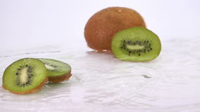 A Several Slices of Kiwi are Falling on the Table. stock video footage