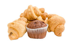 Several small croissant and chocolate muffin on a light backgrou Royalty Free Stock Images