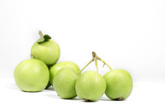 Several small green apples  on white, noncommercial variety Royalty Free Stock Photos