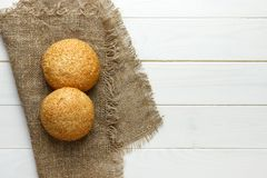 Several small multi grain triangular shaped bread sprinkled with whole sunflower seeds, flax and sesame seeds on a sackcloth Stock Images
