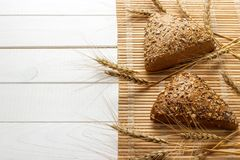 Several small multi grain triangular shaped bread sprinkled with whole sunflower seeds, flax and sesame seeds and wheat and barley Royalty Free Stock Photos