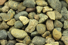Several small river pebbles  background. Several small river pebbles abstract background Royalty Free Stock Photo
