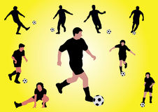 Several soccer players shooting a ball Stock Image