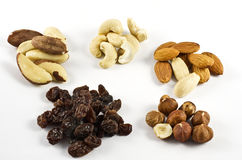Several sorts of nuts. Nuts and raisins on white Royalty Free Stock Photos