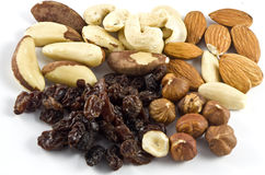 Several sorts of nuts. Nuts and raisins on white stock photography