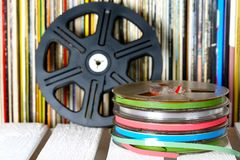 Set of sound recording tapes, media for music and sound. Several sound recording tapes are shown on the background of vinyl records. Media for music and sound Royalty Free Stock Images