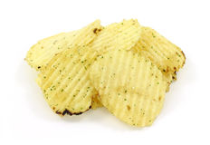 Several sour cream and onion potato chips Stock Photos