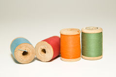 Several spools of thread of different colors on a white Royalty Free Stock Photo