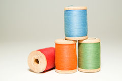 Several spools of thread of different colors on a white Royalty Free Stock Photography