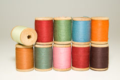 Several spools of thread of different colors on a white Stock Photography