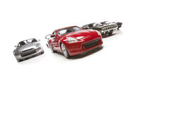 Several Sports Cars Racing On White Stock Images