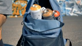 Several spray cans carried away by a man. stock video footage