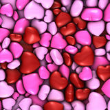 Several stacked hearts of all colors background Stock Images