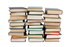 Several stacks of books. On a white background stock image