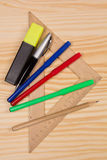Several stationery on a wooden table Stock Images