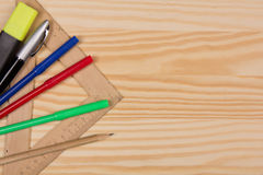 Several stationery on a wooden table Royalty Free Stock Images