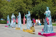 Several Statue of Liberty Actors Royalty Free Stock Image