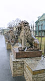 Several statues of bronze lions along the fence Stock Photo