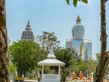 Several statues of Buddha posture. Big white Buddha statue in front of Royalty Free Stock Image