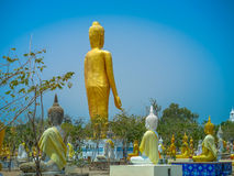 Several statues of Buddha posture. Big white Buddha statue in front of Stock Photography