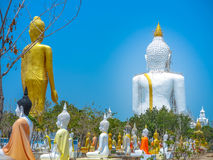 Several statues of Buddha posture. Big white Buddha statue in front of Royalty Free Stock Photo