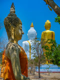 Several statues of Buddha posture. Big white Buddha statue in front of Stock Images