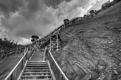 Several Steps to the Top. Wood steps to the top of the mountain with several rest stops along the way Royalty Free Stock Image