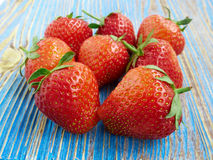 Several strawberries. Few ripe strawberries on a blue background Stock Image