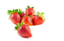 Several strawberries on a saucer focus on the front. On a white background Royalty Free Stock Photo