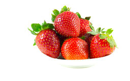 Several strawberries on a saucer Stock Photo