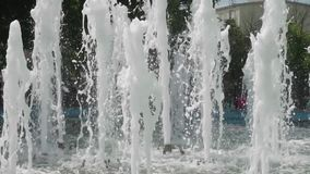 Several streams of water of city fountain stock video footage