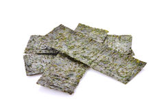 Several strips of dried seaweed sheets  on a white backg. Several strips of dried seaweed sheets  on a white Royalty Free Stock Photo