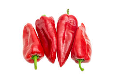 Several sweet red Kapia peppers on a light background Royalty Free Stock Photos