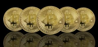 Golden bitcoins on black background Royalty Free Stock Images