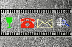 Several symbols are depicted on film imitation. A set of symbols depicted in the imitation of film stock images