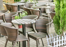 Several table and black chair in the cafe garden Royalty Free Stock Image