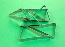 Several tablecloth clamps on green background Royalty Free Stock Images