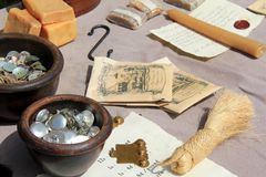 Interesting scene of several items that soldiers and their wives might sell seen at war reenactment, Fort Ontario, New York, 2016. Several tables covered with Royalty Free Stock Images
