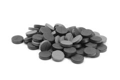 Several tablets of activated charcoal Royalty Free Stock Photography