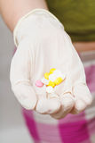 Several tablets in gloved hand Royalty Free Stock Photography