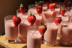 Several tall glasses of fruit smoothies Royalty Free Stock Photo