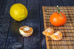 Several tangerines and lemon Stock Images