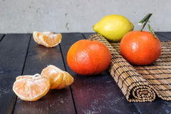 Several tangerines and lemons Royalty Free Stock Image