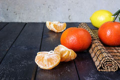 Several tangerines and lemons Stock Photos