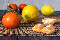 Several tangerines and lemons Stock Photo
