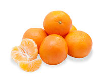 Several tangerines, one cleaned and disassembled i Royalty Free Stock Photo