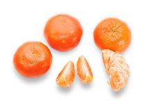 Several tangerines, one purified and separated into segments iso Stock Photos