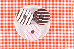 Several tasty doughnuts on plate Stock Photo
