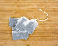 Several teabags on wood Royalty Free Stock Photo